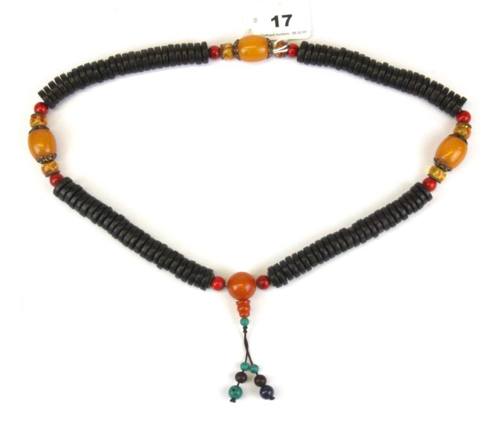 A strand of Tibetan prayer beads, folded L. 42cm bead Dia. 2cm. (Mixed wood and other materials)