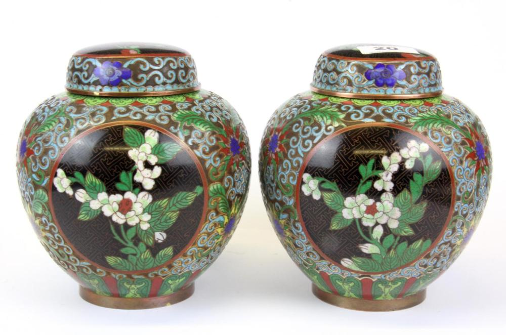 A pair of mid 20th Century Chinese cloisonne on copper jars and lids, H. 17cm.