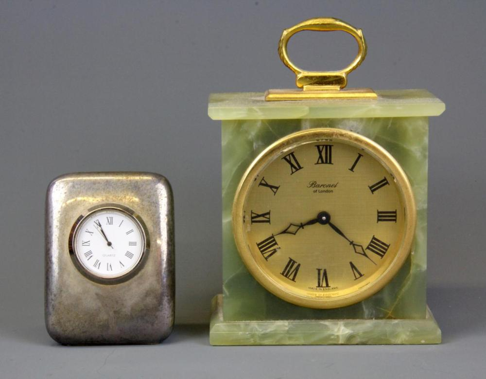 An onyx mantle clock, H. 14cm together with a silver plated desk clock.