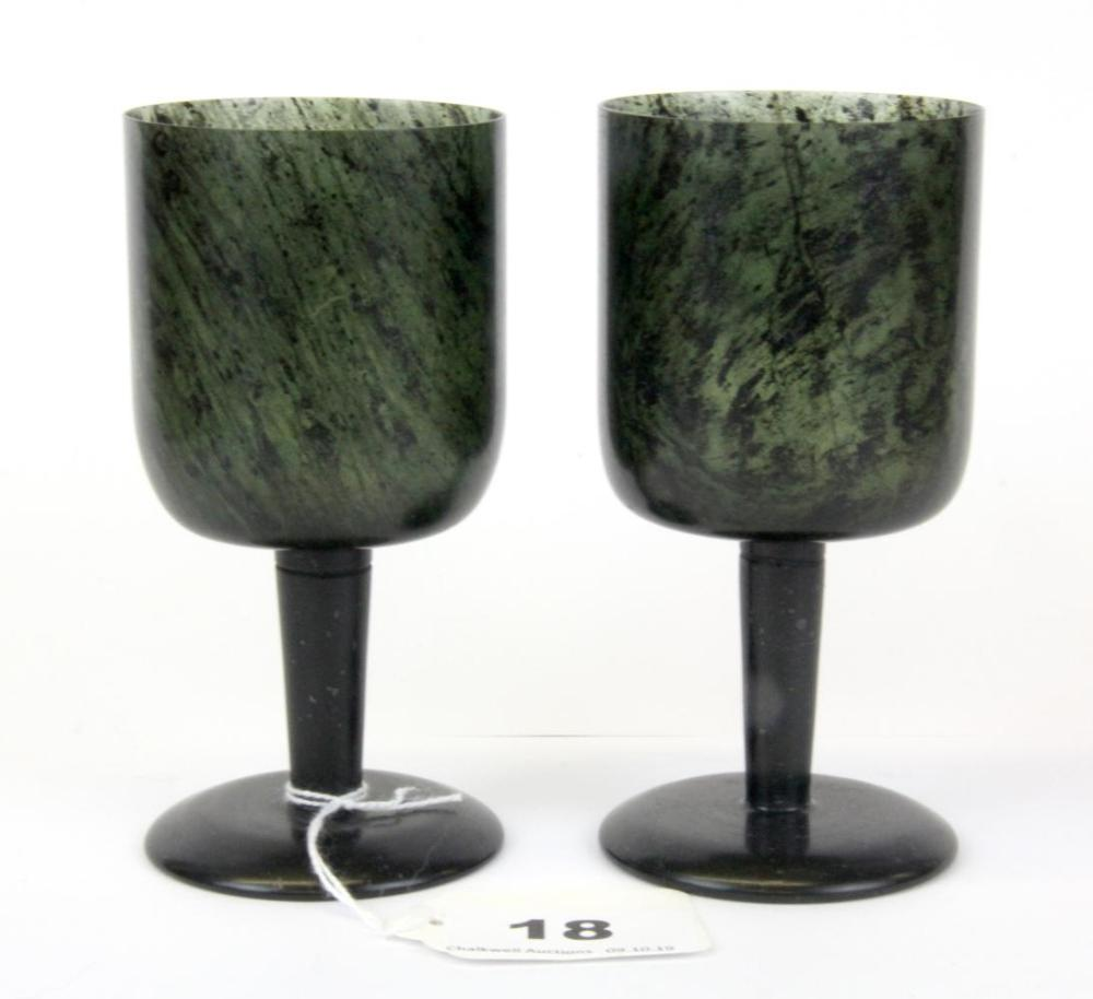 A pair of fine Chinese spinach jade wine cups, H. 11.5cm.