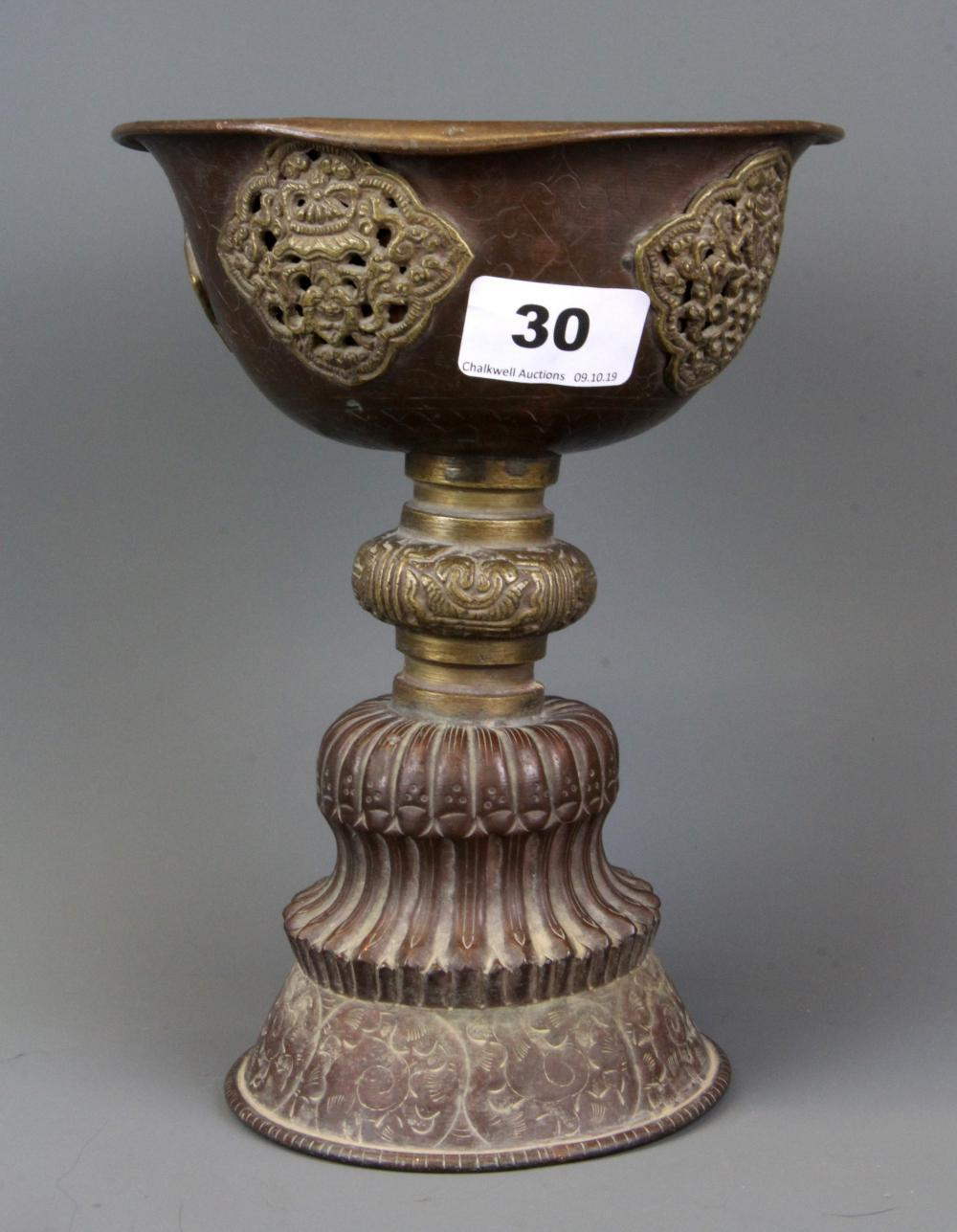A large antique Tibetan hammered copper and brass Yak butter votive holder, H. 20cm.