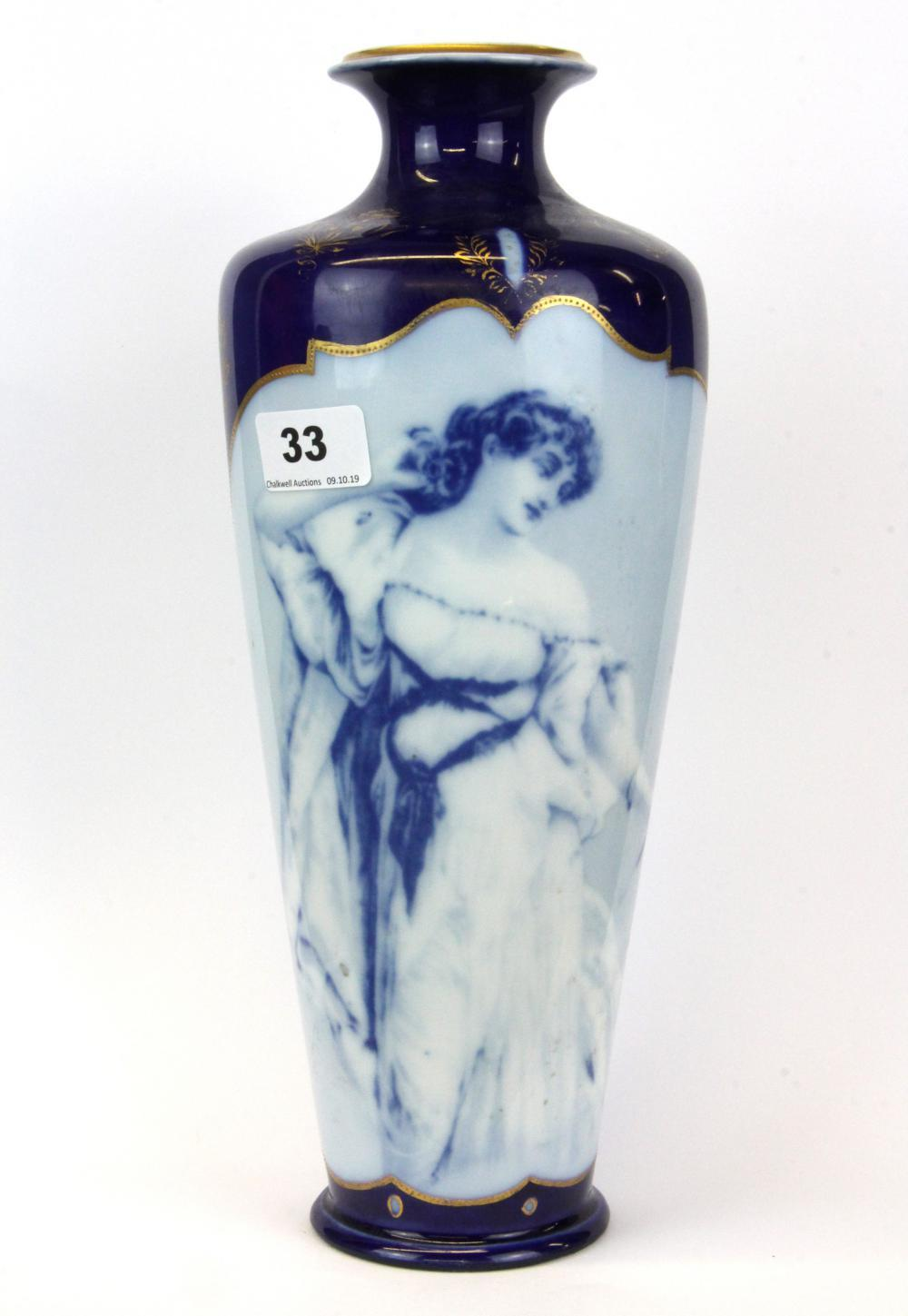 A lovely early 20thC Copenhagen porcelain vase, H. 34cm.