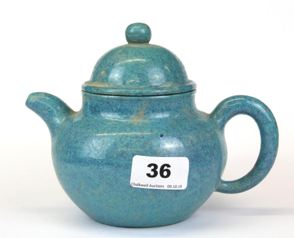 A Chinese Yixing terracotta teapot with robins egg glaze, H. 14cm