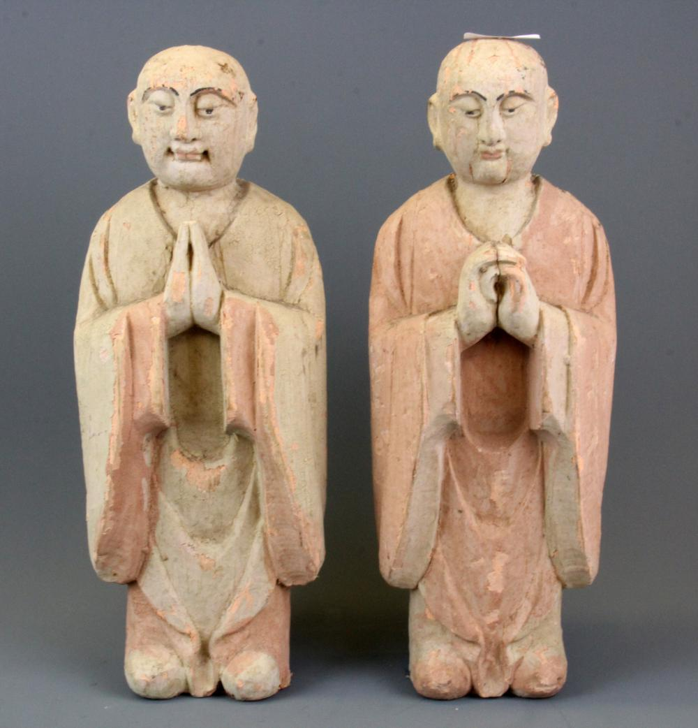 Two painted carved wooden figures of monks, H. 36cm.