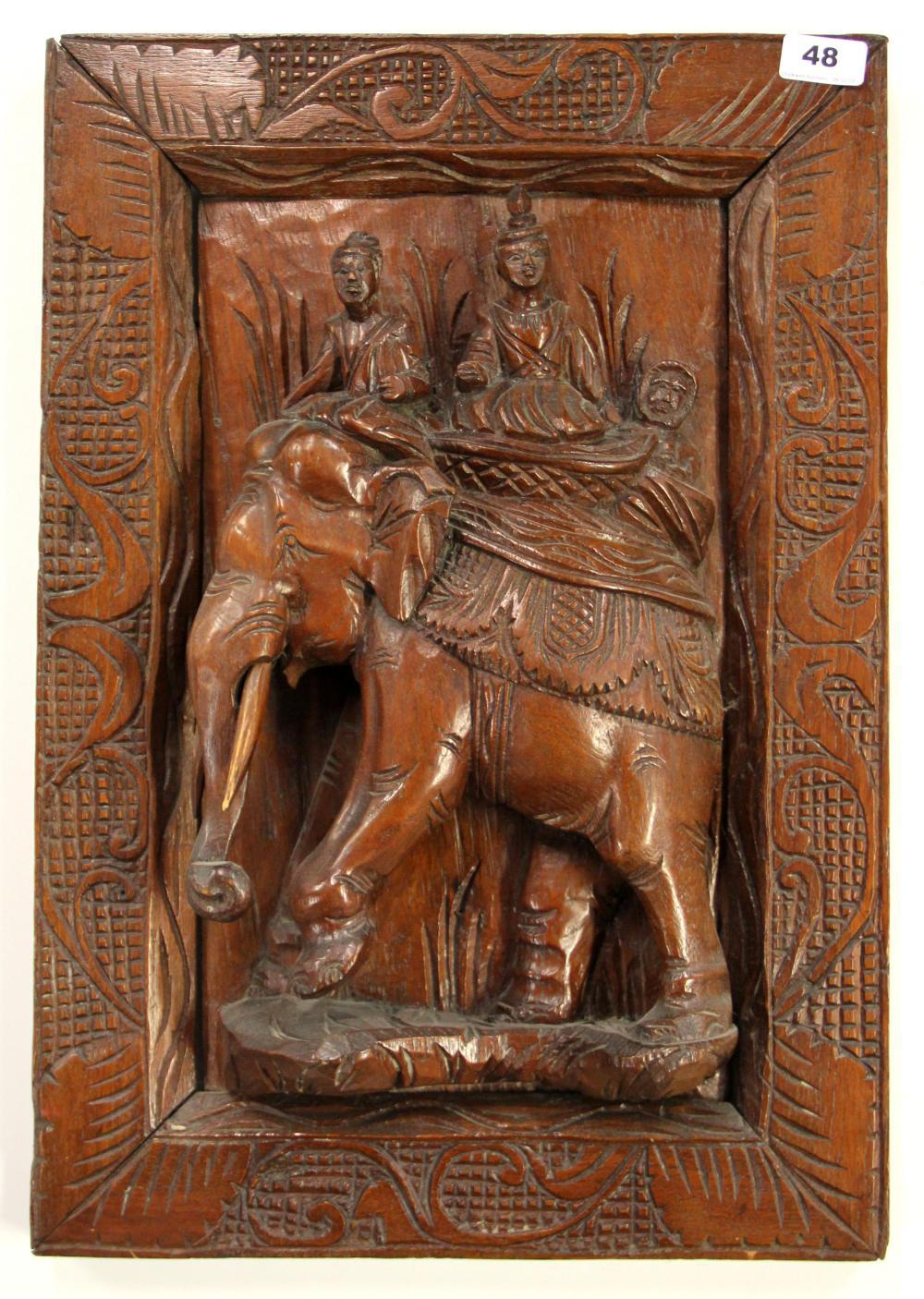 A Burmese carved teak panel, 39 x 56cm.