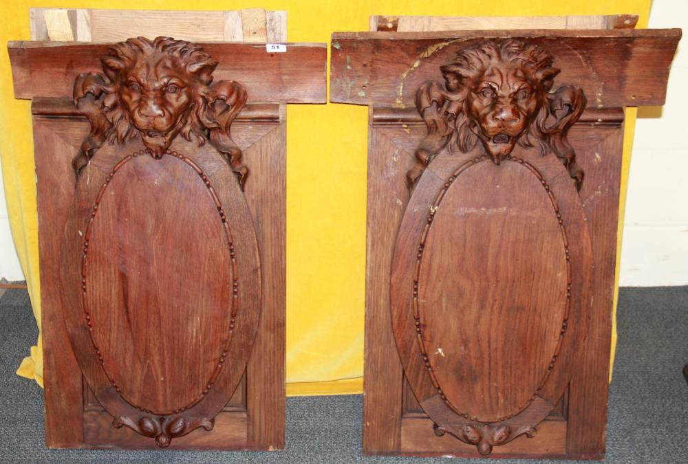 A pair of superb carved 19th Century hardwood wall panels on pine frames featuring lions heads, W. 67cm H. 94cm.
