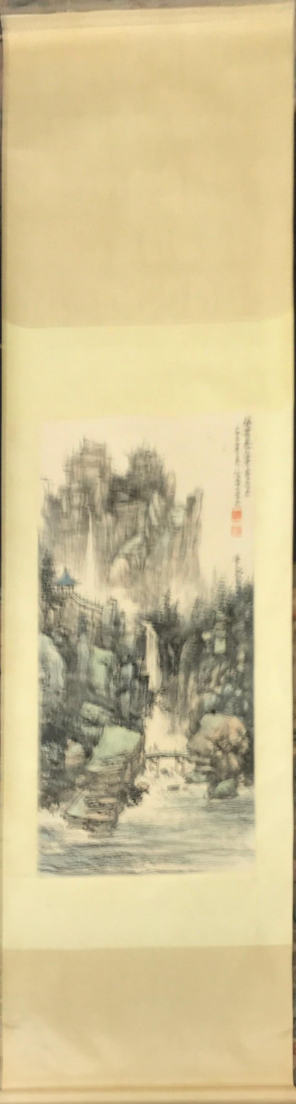 A silk mounted Chinese scroll painting of a mountain landscape, W. 68cm L. 209cm.