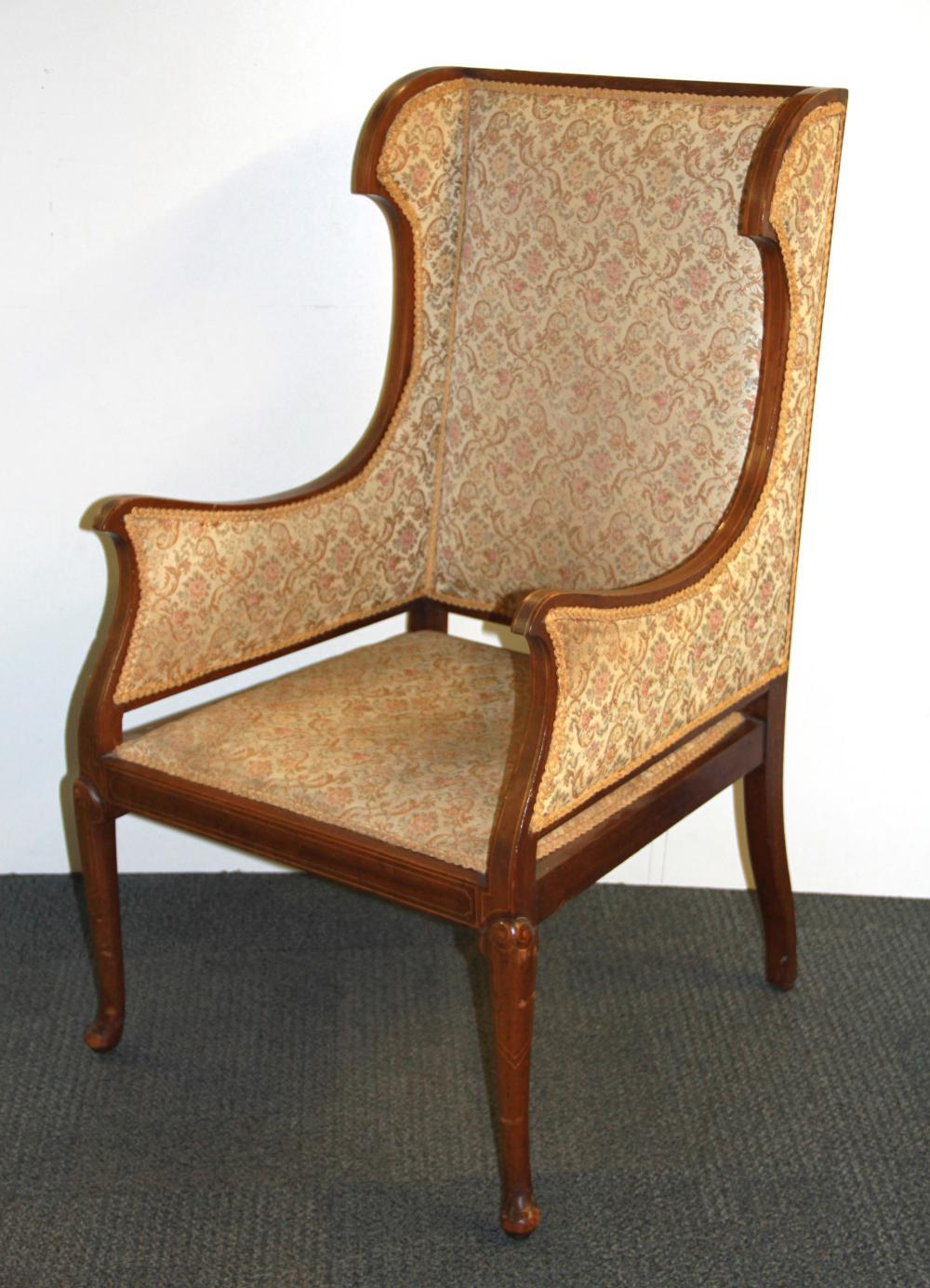 A pretty Edwardian inlaid mahogany armchair.