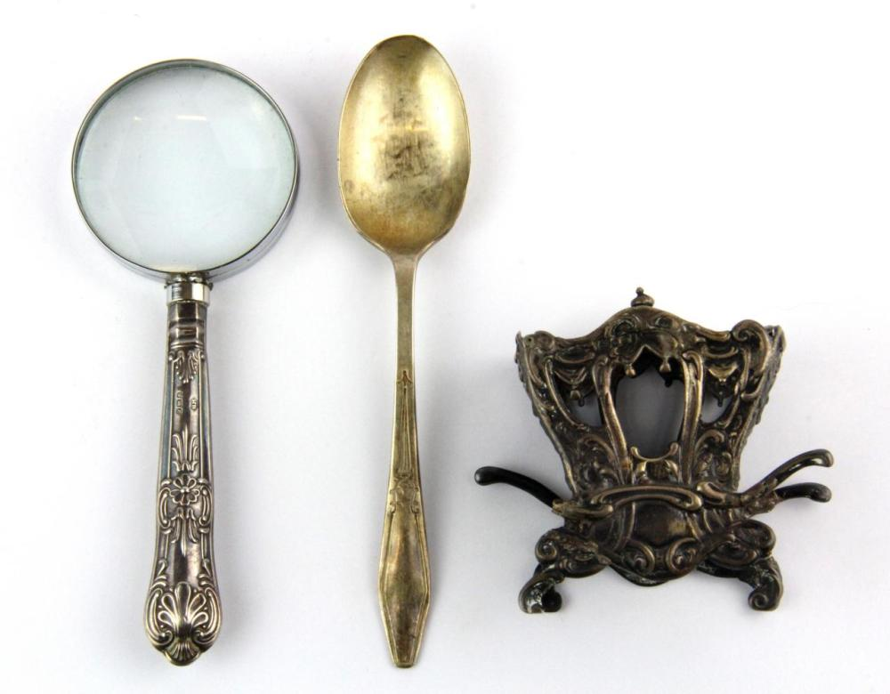 A 930 silver miniature carriage, H. 6.5cm (A/F) together with a silver handled magnifying glass and a silver spoon.