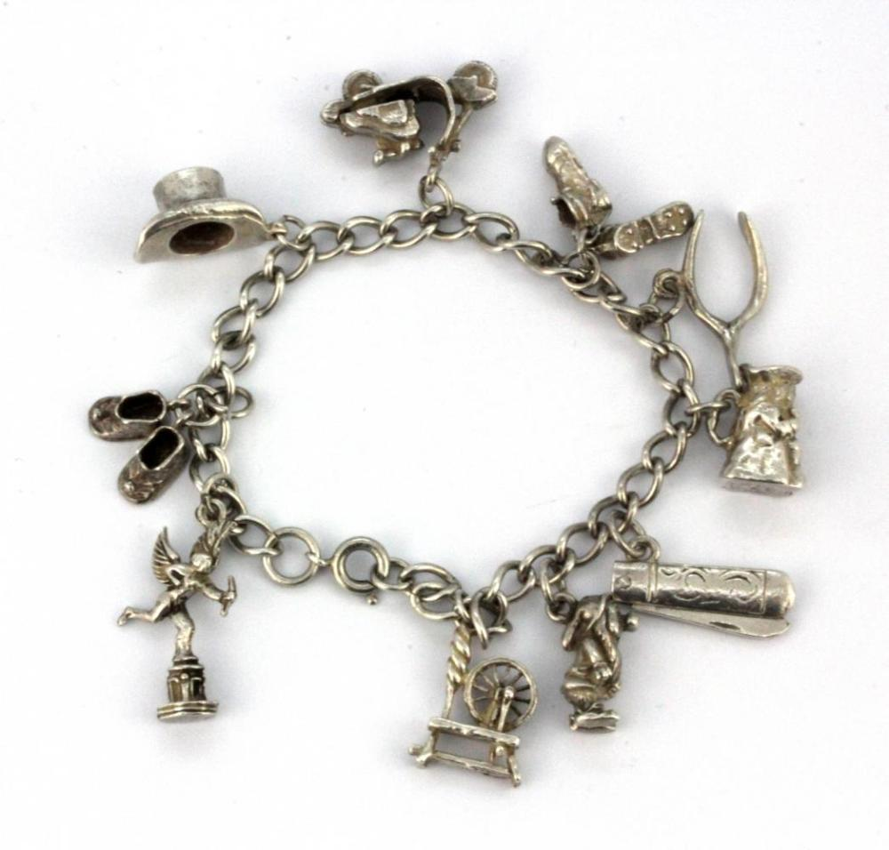 A sterling silver and other charm bracelet.