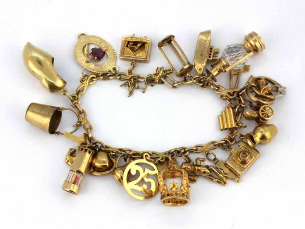 A 9ct yellow gold charm bracelet and a large quantity of mainly 9ct gold charms.