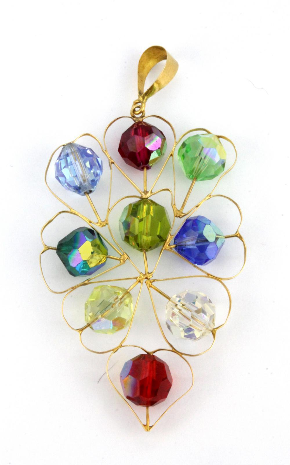 A yellow metal (tested high carat gold) stone set pendant, L. 6cm.