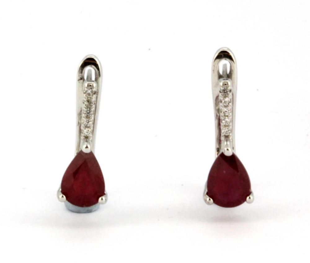 A pair of 925 silver earrings set with pear cut rubies and white stones, L. 1.4cm.
