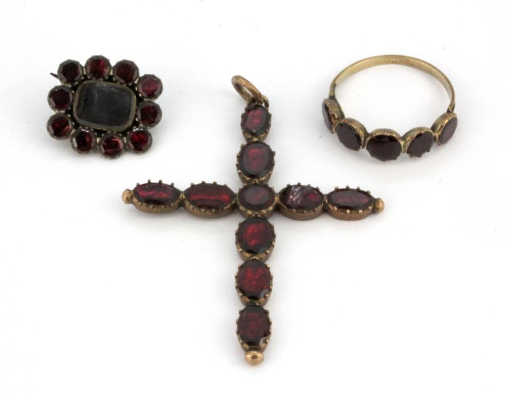 A Georgian / early Victorian flat cut foiled ring, mourning brooch and cross pendant (one garnet a/f), brooch 1.7 x 1.5cm, ring (N), pendant