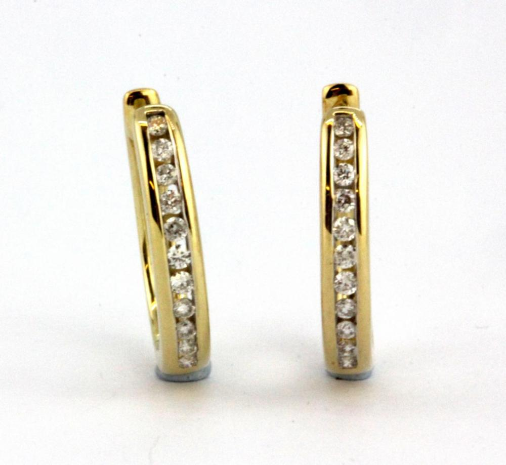 A pair of 9ct yellow gold diamond channel set hoop earrings, L. 1.5cm.
