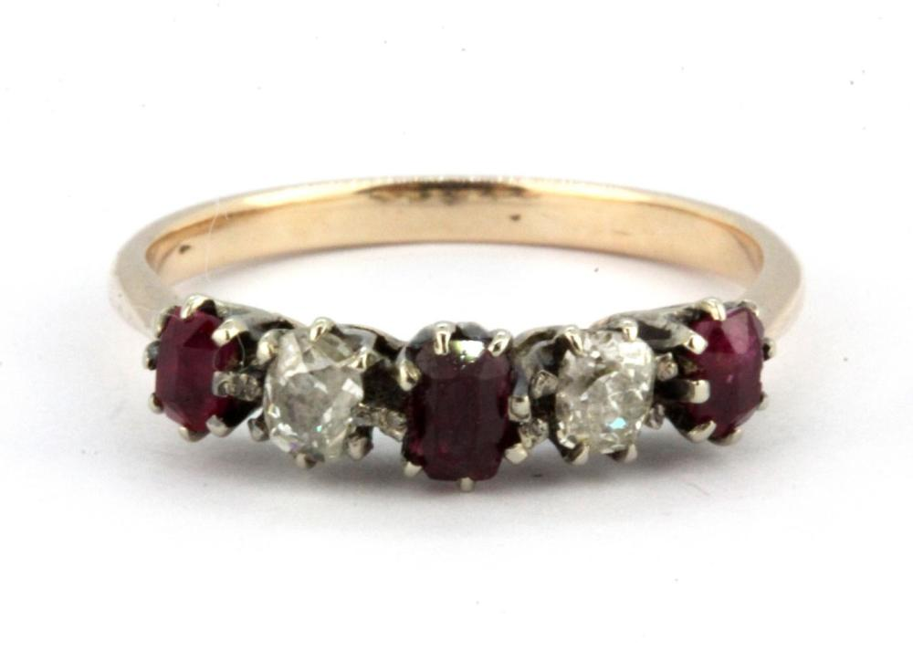 A yellow metal (tested high carat gold) ring set with old cut diamonds and rubies, (wear to rubies), (R).