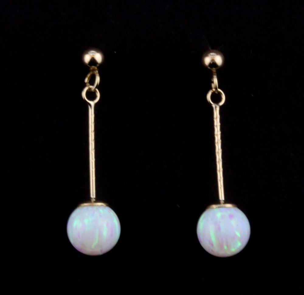 A pair of 9ct yellow gold synthetic opal ball drop earrings, L. 2.5cm.