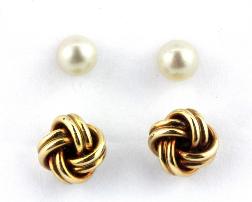 A pair of 9ct yellow gold stud earrings.