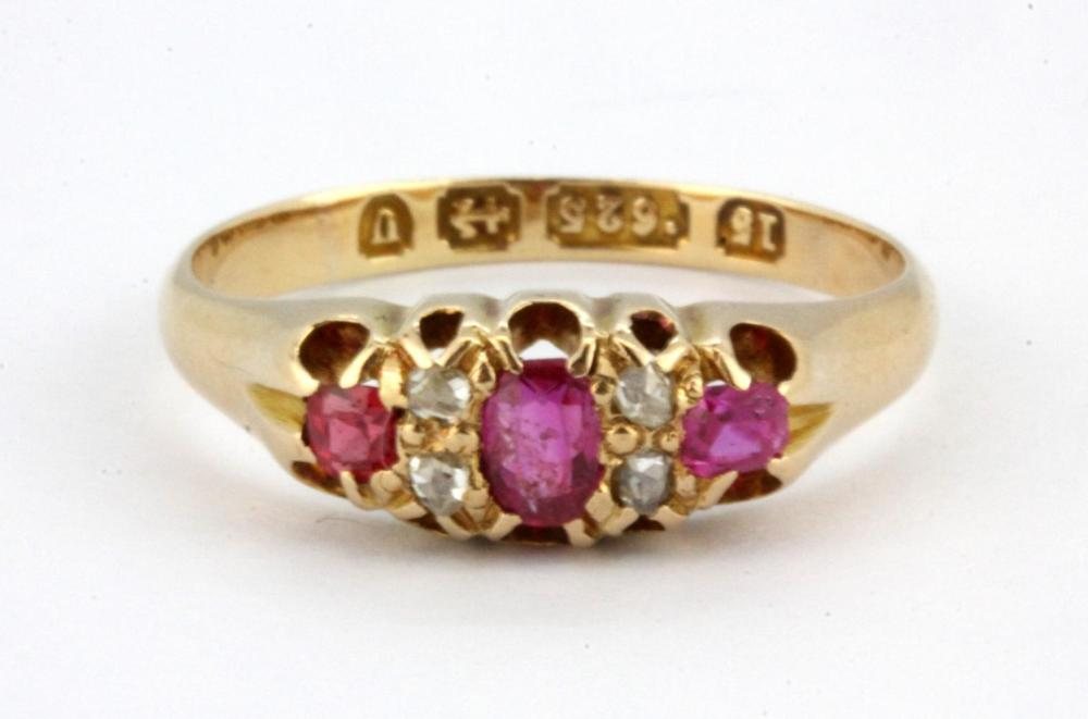 A 15ct yellow gold ruby and diamond set ring, (K).
