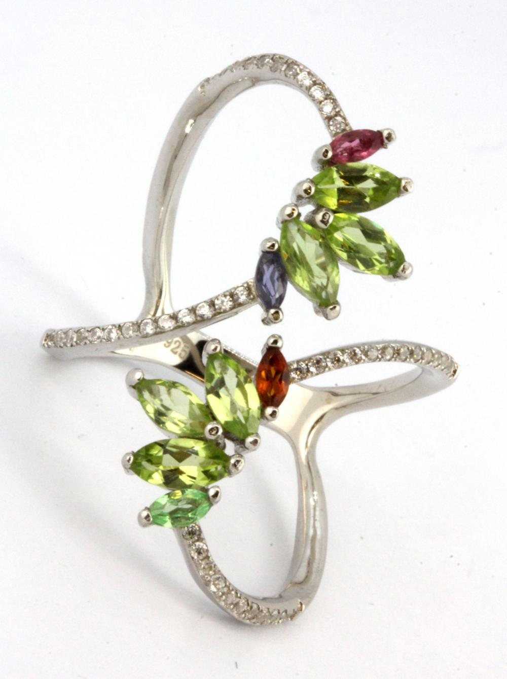 A 925 silver ring set with marquise cut peridots and other semi-precious stones, (T).