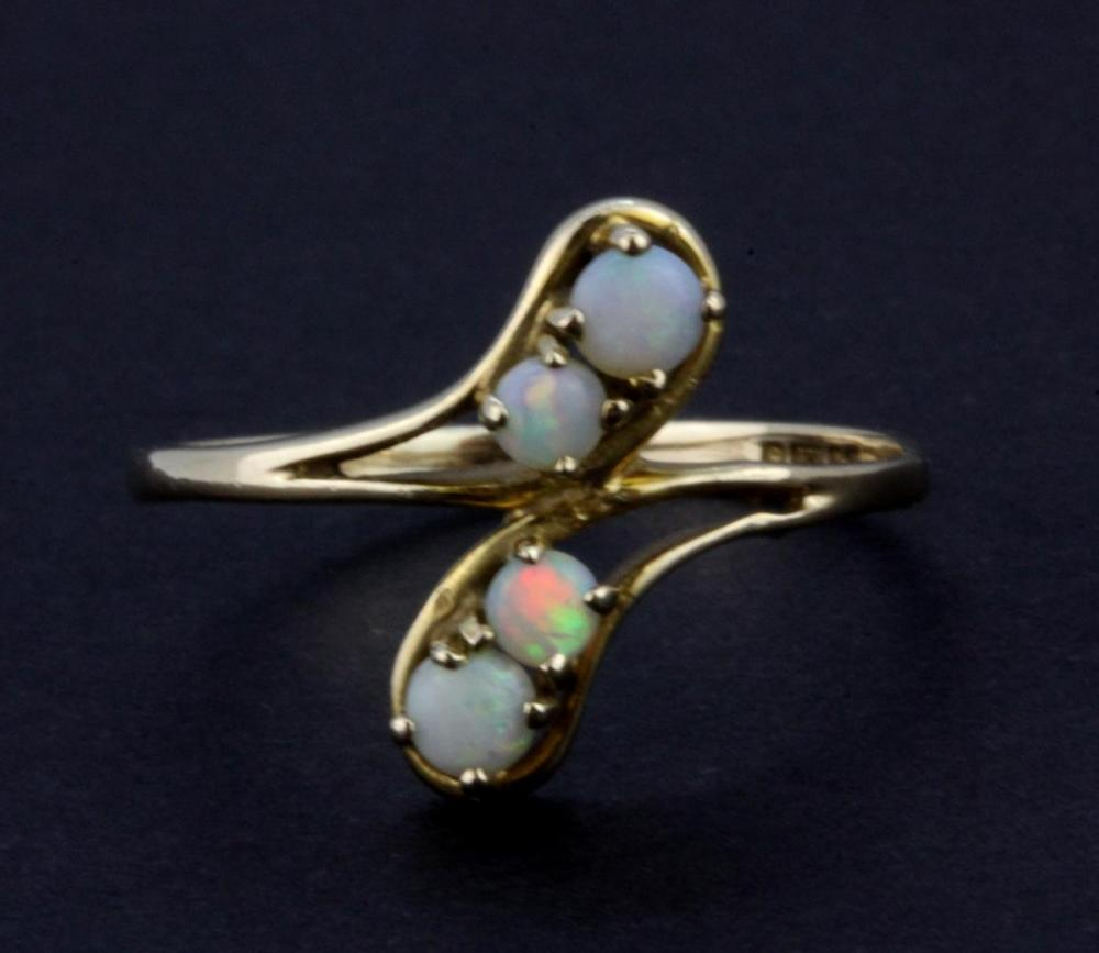 A 9ct yellow gold opal set ring, (P.5).