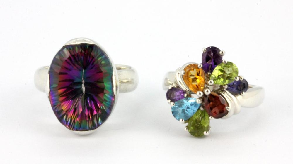 A 925 silver ring set with pear cut semi-precious stones together with a further stone set silver ring, (L.5).