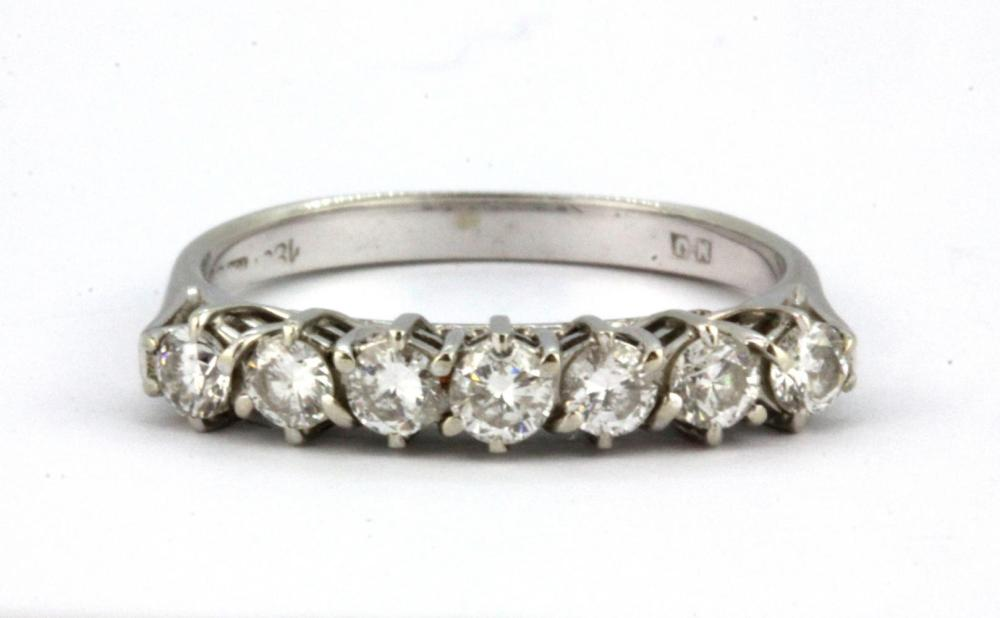 An 18ct white gold ring set with seven brilliant cut diamonds, approx. 0.7ct overall, (M.5).
