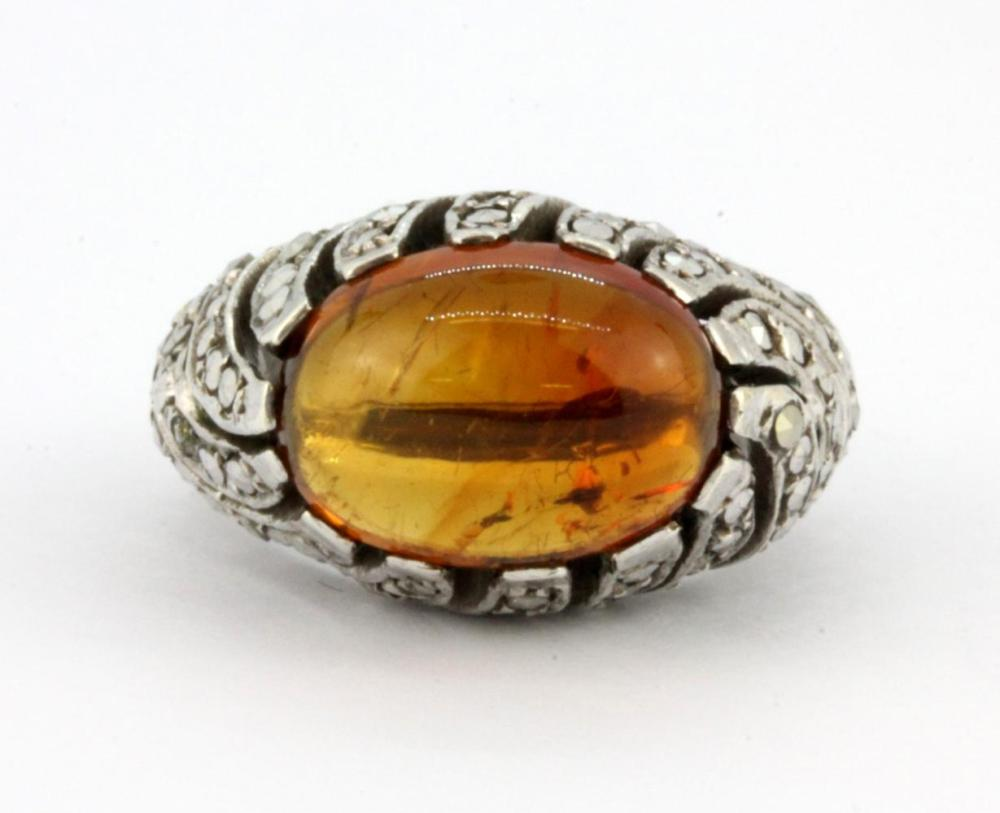 A 925 silver and marcasite ring set with amber, (N.5).