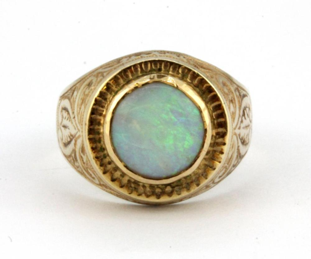 A gentleman's yellow metal (tested high carat gold) signet ring set with an opal doublet, (M).