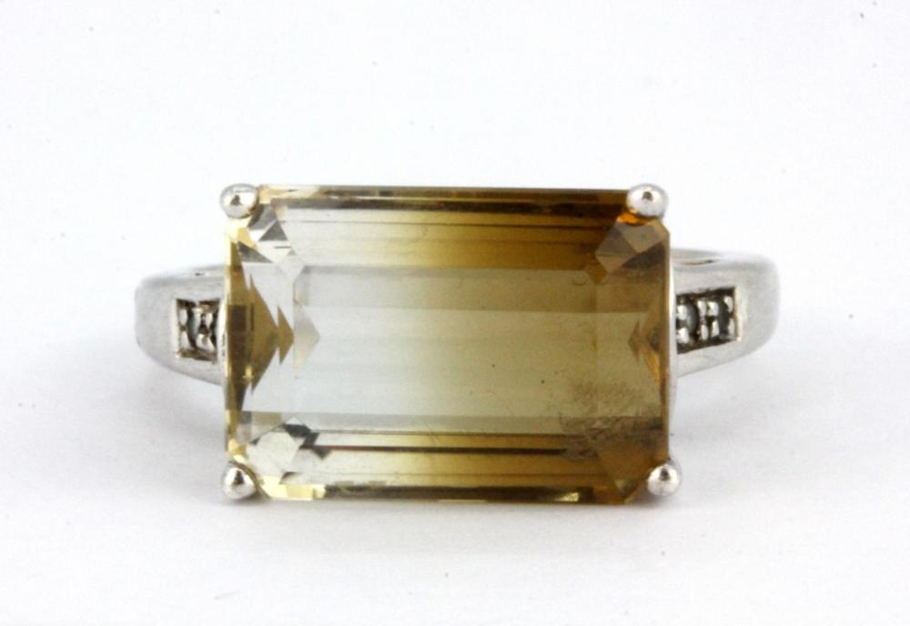A 925 silver ring set with an emerald cut bi-colour quartz, (P).