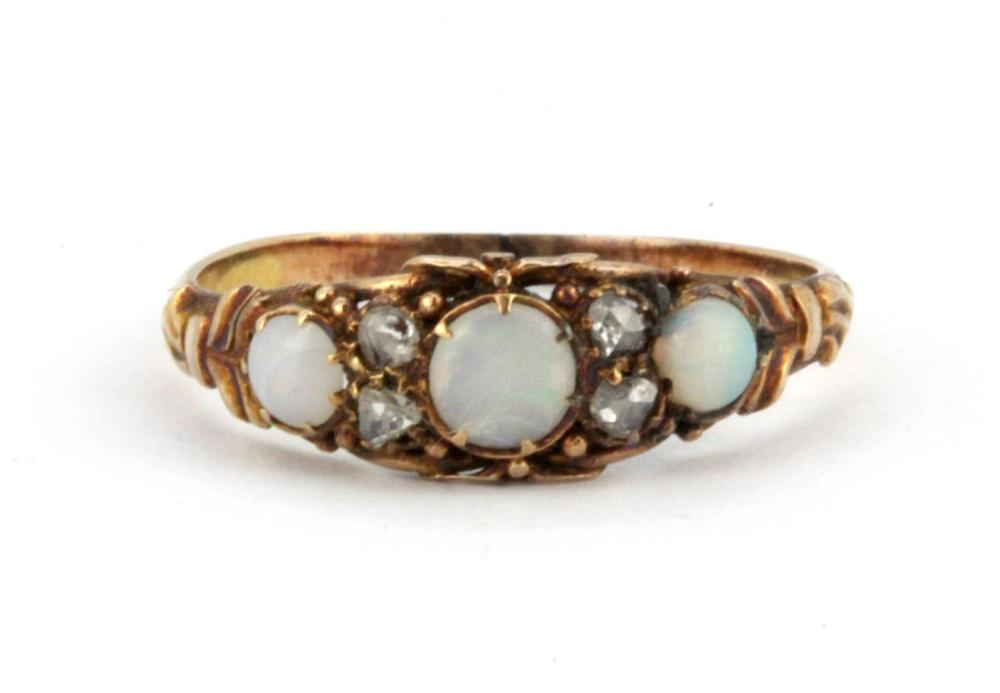 A yellow metal (tested 9ct gold) opal and diamond set ring, (O).