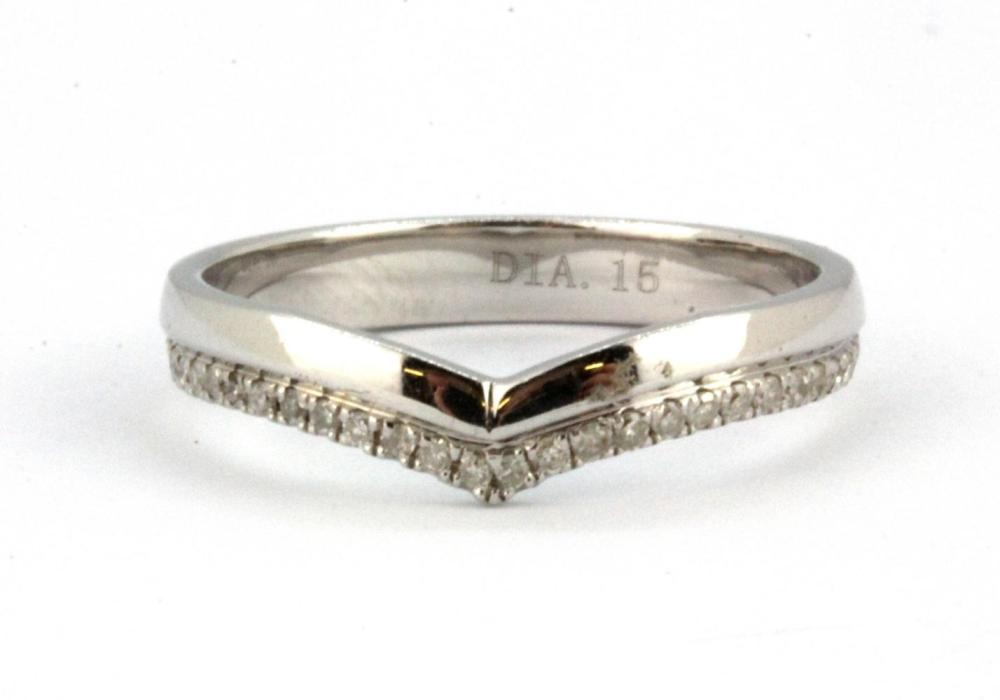 A 9ct white gold diamond set wishbone ring, (N.5).