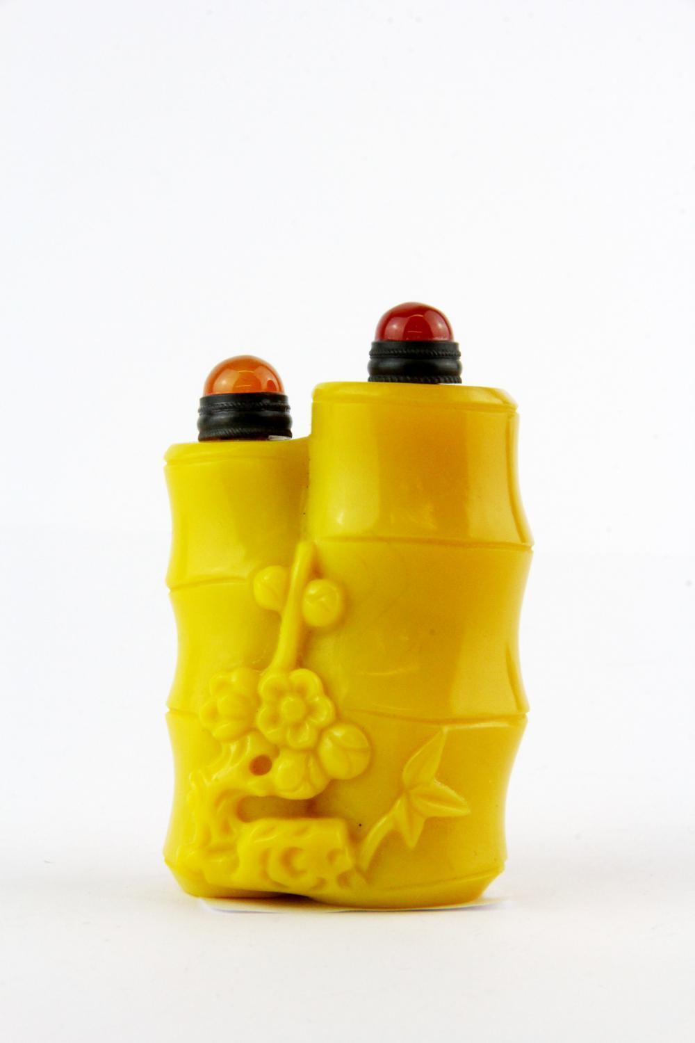 An unusual Chinese Imperial yellow carved Peking glass double snuff bottle of stems of bamboo, H. 7.5cm.