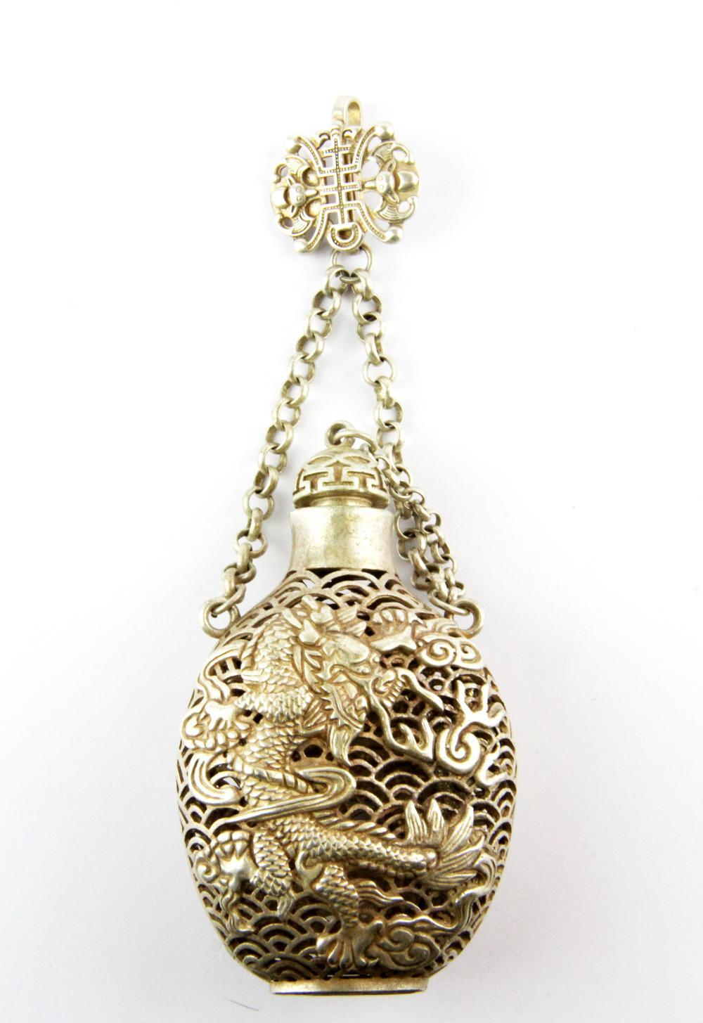 A Chinese white metal snuff bottle shaped pomander, H. 15cm.