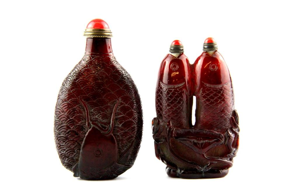 Two interesting Chinese carved faux amber fish snuff bottles, tallest H. 9cm.