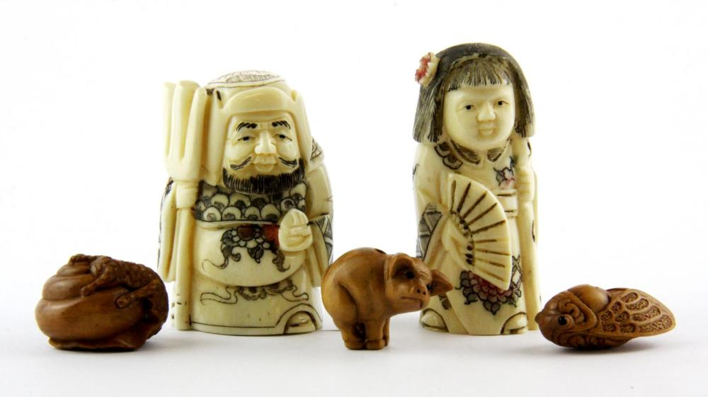 Two carved bone figural netsuke and three fruitwood ojime, netsuke H. 5cm.