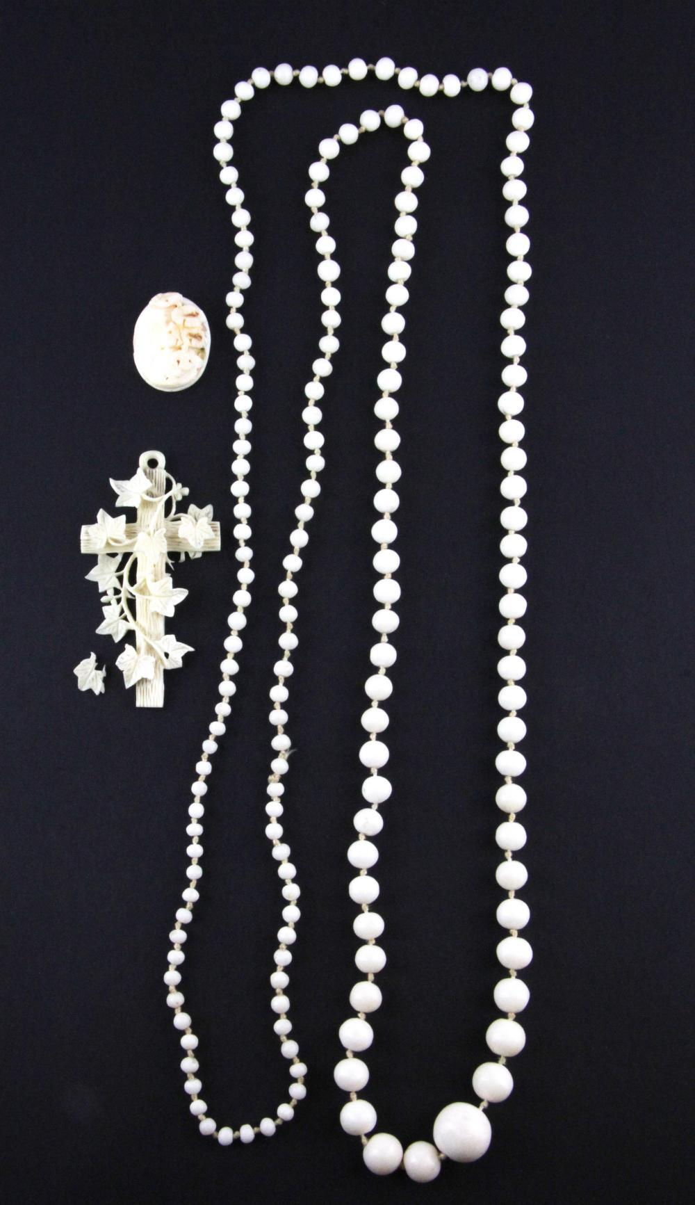 A Victorian coral necklace and a Victorian carved ivory cross, cross H. 8cm.