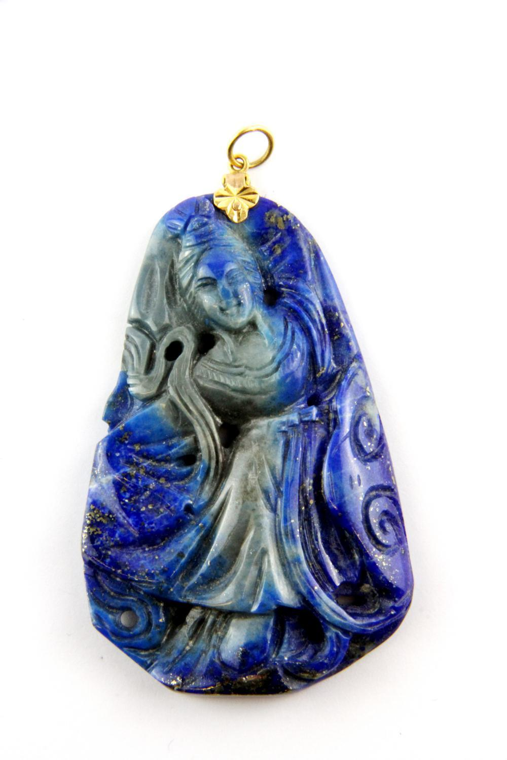 An old Chinese carved lapis lazuli pendant of a dancing Tang lady with a yellow metal tested high carat gold fitting, H. 7.5cm.