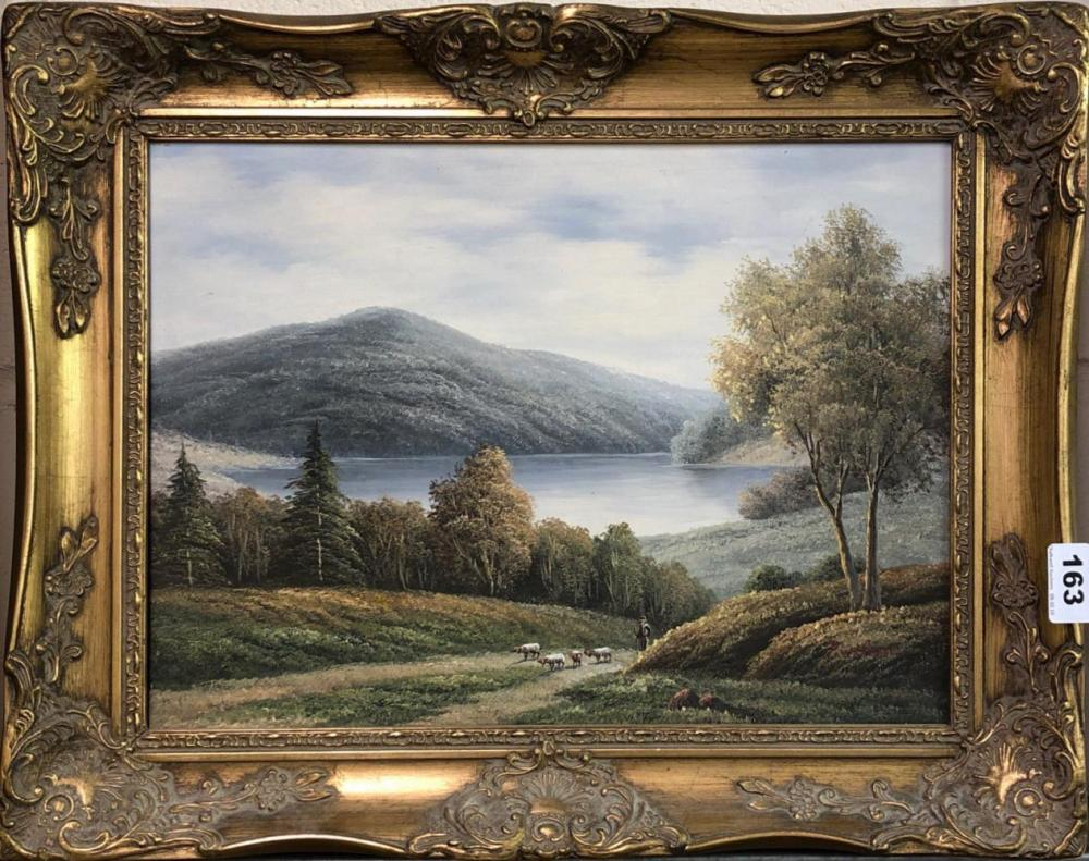 A gilt framed oil on canvas of a lakeland scene signed P. Wilson, framed size 51 x 41cm.