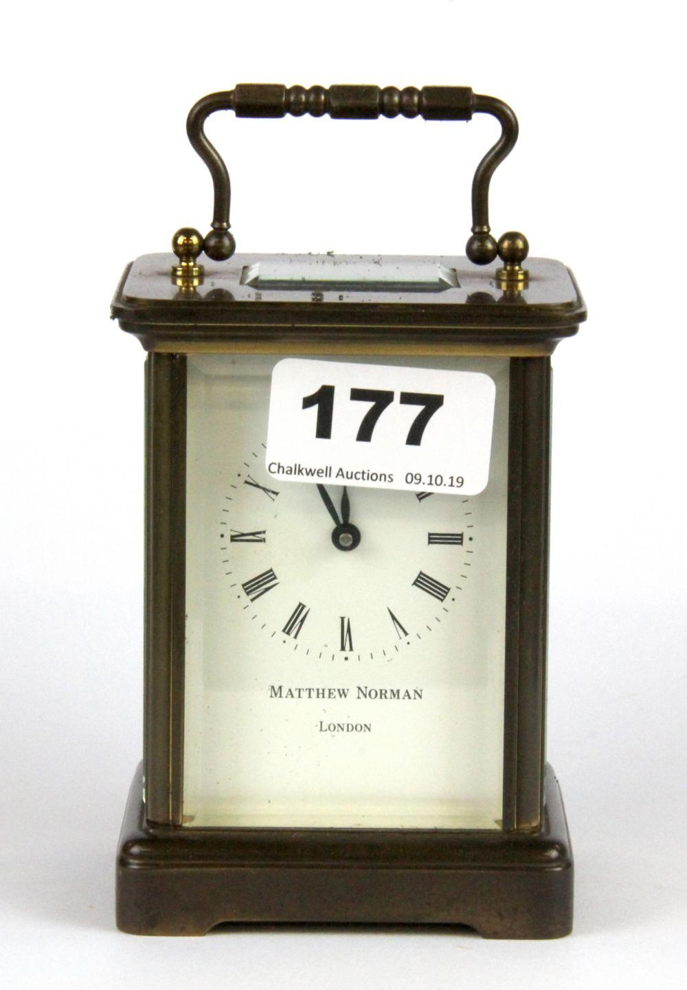 A Matthew Norman, London brass carriage clock with original box, H. 15cm.