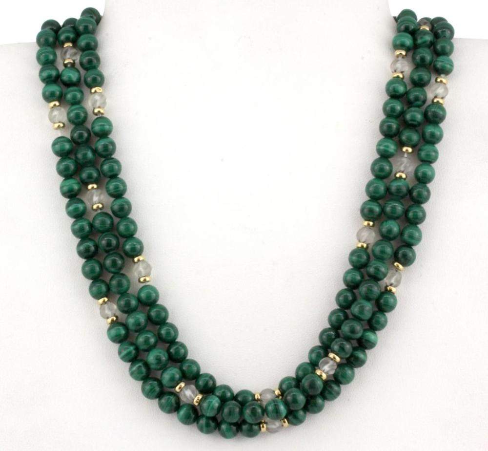 A yellow metal (tested 18ct gold) and malachite necklace, L. 40cm.
