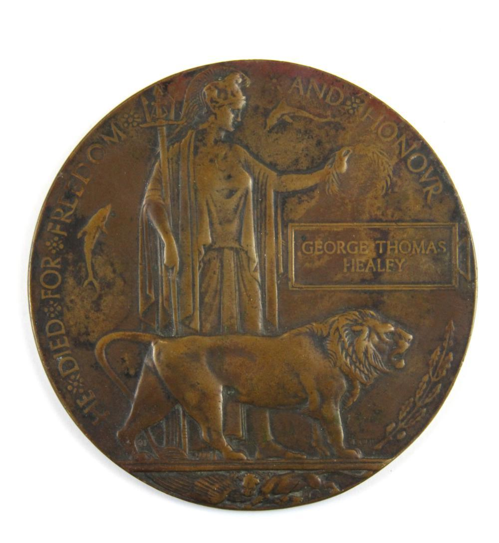 A First World War bronze death plaque for George Thomas Healey, Dia. 12cm.