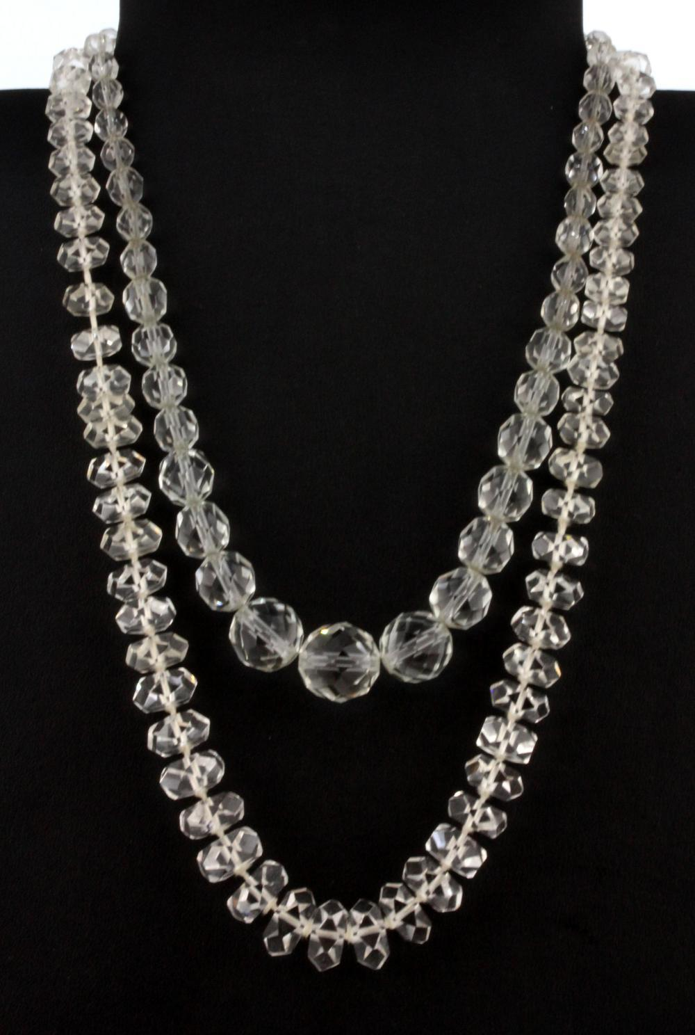 A cut rock crystal graduated necklace and a further glass necklace, L. 50cm & 40cm.