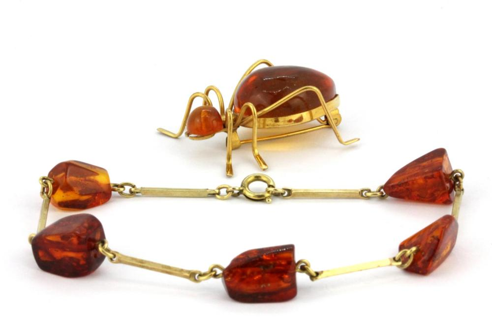 A yellow metal amber set insect shaped brooch together with a yellow metal amber set bracelet.