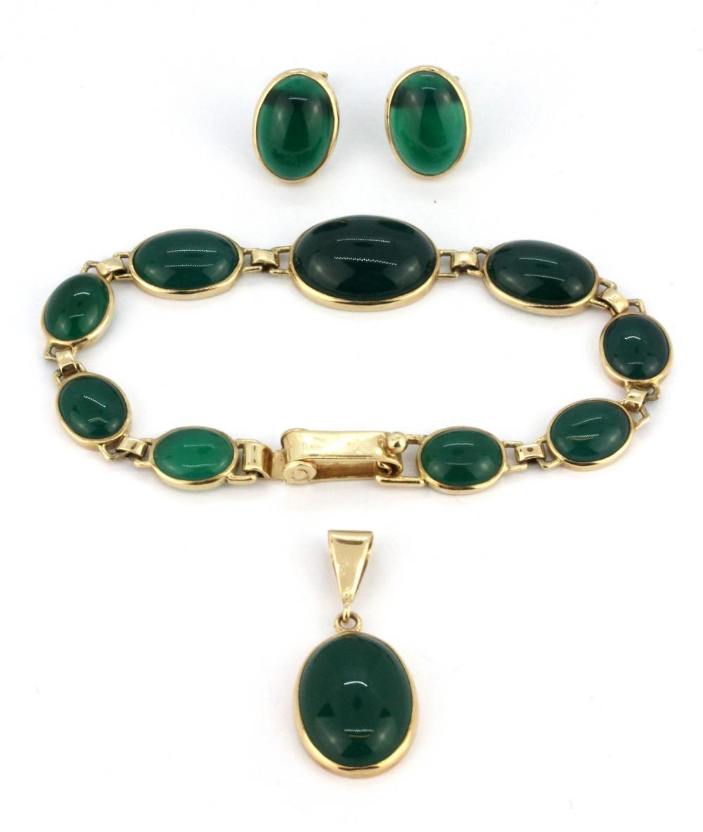 A 9ct yellow gold suite of matching bracelet, pendant and earrings, set with cabochon cut green agate.