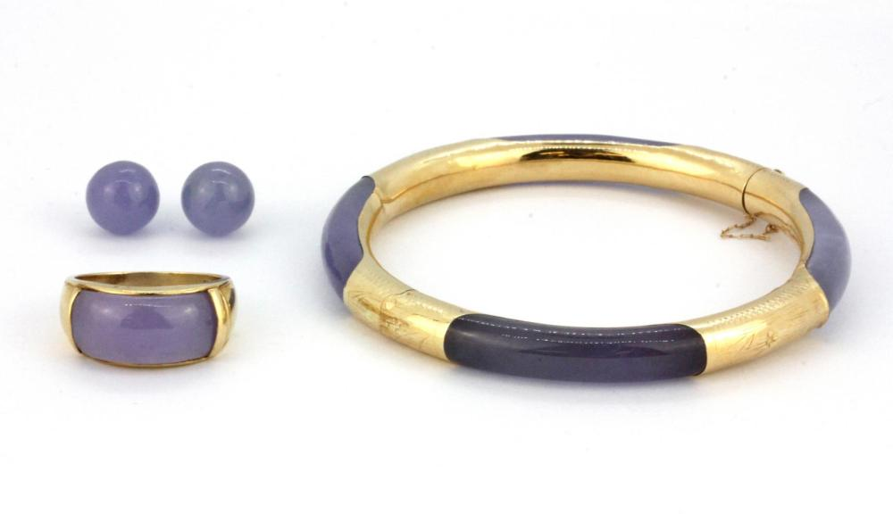 A 14ct yellow gold (stamped 14k) bangle set with lavender jade, together with a 14ct gold lavender jade ring and a similar pair of yellow me