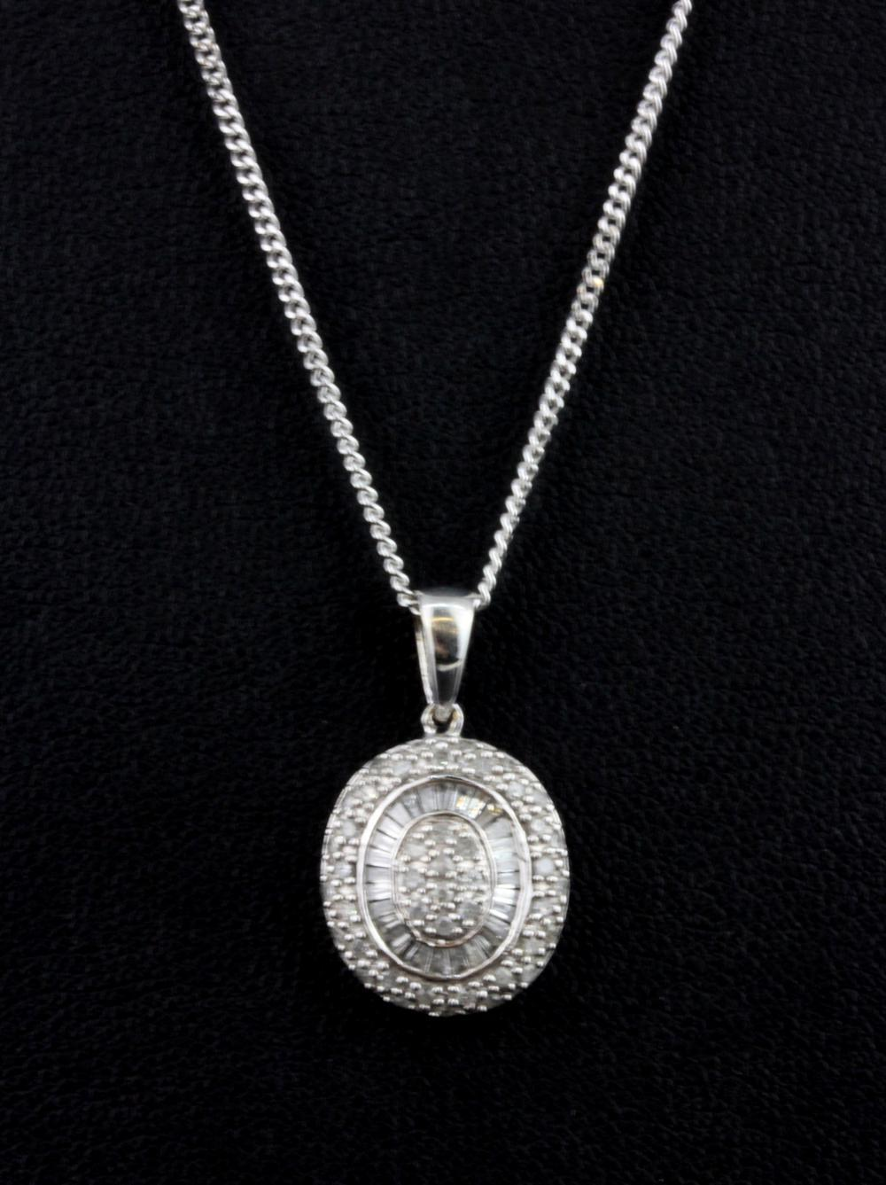 A 9ct white gold diamond set pendant and chain.