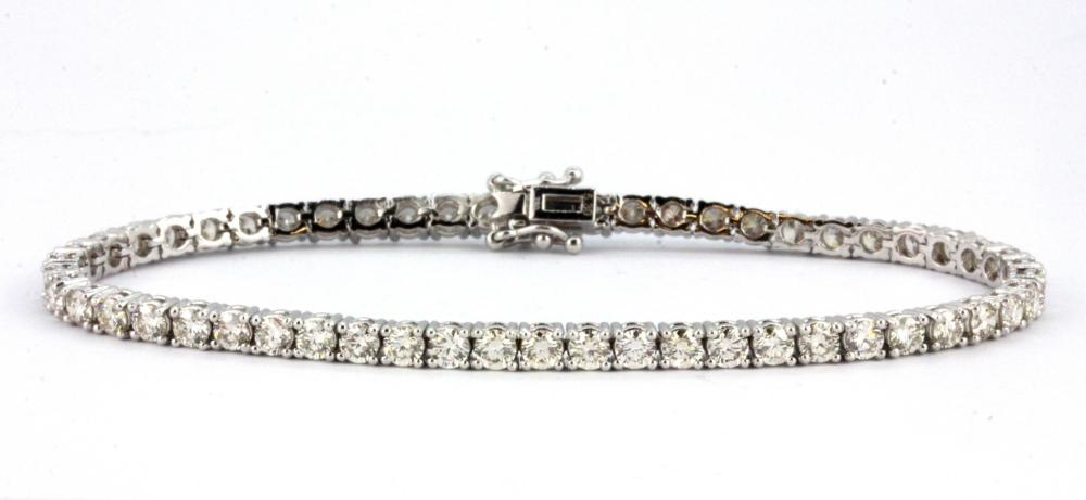 An 18ct white gold (stamped 750) line bracelet set with brilliant cut diamonds, approx. 5.3ct, L. 17.5cm.