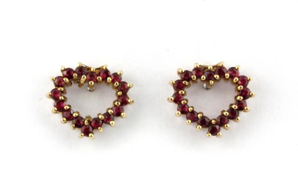 A pair of 9ct yellow gold ruby set heart shaped earrings, 1. 2 x 1.1cm.