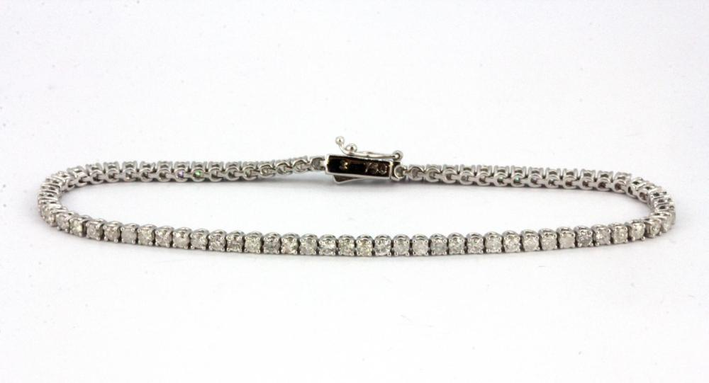 An 18ct white gold (stamped 750)  diamond set line bracelet, L. 18cm.